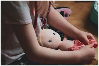 teach newborn care to siblings